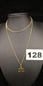 1 Chaine fine maille gourmette (L 58 cm fermoir cassé) et 1 pendentif signe balance. Le tout en or. PB 5g