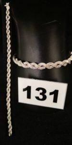 1 Bracelet en or gris tressé orné de petits diamants (L 19cm, fermoir de sécurité ). PB 14,4g