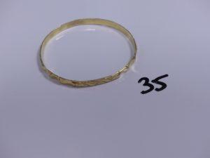 1 bracelet rigide et ouvragé en or (Diamètre 6,5cm). PB 16,5g