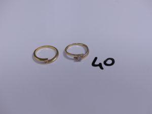 2 bagues en or (1 bicolore rehaussée d'un petit diamants Td54)(1 ornée d'un petit diamant Td54). PB 4,8g