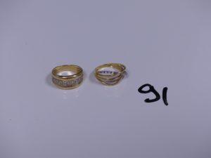 2 bagues en or (1 bicolore ornée d'un rang de petites pierres Td53)(1 ornée de petits diamants Td53). PB 7,7g