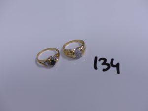 2 bagues en or (1 ornée de diamants, Td52)(1 bicolore réhaussée d'une pierre bleue, Td55). PB 5,2g
