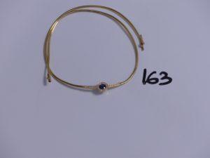 1 collier en or maille serpentine (abîmé) motif central orné d'une pierre bleue entourée de petits diamants (L42cm). PB 11,9g