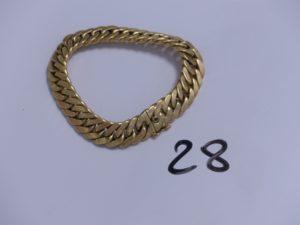1 Bracelet en or maille gourmette orné d'une pierre bleue cabochon au fermoir (L20cm). PB 24,9g