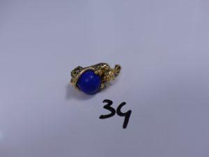 1 Pendentif panthère en or monté sur une pierre style lapis lazuli. PB 8,7g
