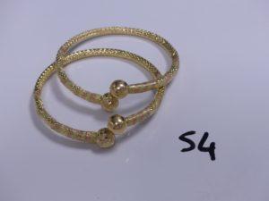 2 Bracelets 3 ors rigides à décor de 2 boules (Diamètre 7cm). PB 27g