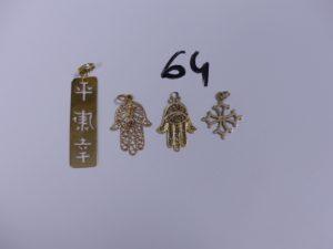 3 Pendentifs en or (1 à décor d'une main ornée d'une petite pierre rouge)(1 à décor d'une main)(1 à décor de signes du zodiaque chinois) et 1 croix du sud en or. PB 6,7g