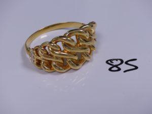 1 Bracelet en or rigide et ouvrant motif central tréssé (creux, fragile, Diamètre 6cm). PB 15,7g