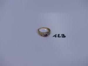 1 bague en or ornée d'une pierre rouge entourage petits diamants (td56). PB 4,1g