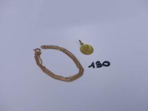 1 chaîne maille plate (L50cm) et 1 médaille de la Vierge et l'enfant. Le tout en or PB 4,3g