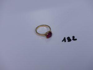 1 bague en or rehaussée d'une pierre rouge (td56). PB 4,3g