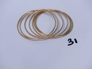 7 bracelets joncs en or (diamètre 5,5cm). PB 31,4g