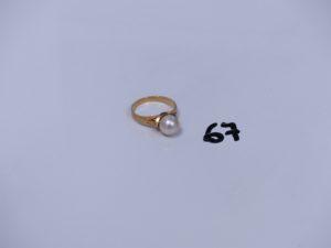 1 bague en or ornée d'une perle (Td53). PB 3,4g