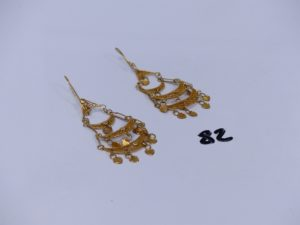 2 pendants en or à motifs filigranés. PB 7,3g