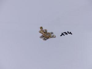 1 pendentif en alliage 14K à décor d'un ourson articulé (H3cm). PB 7,8g