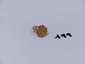 1 bague en or ornée d'une pièce mexicaine (Td52). PB 4,9g