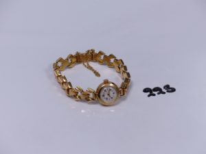 1 montre dame bracelet et boîtier or (HS) avec chaînette de sécurité. PB 21,6g