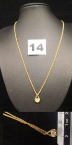 1 Ras de cou en fine maille palmier en or et son pendentif goutte, orné d'un diamant (Diam 0,4cm). PB 5,9g