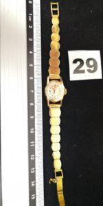 1 Montre de dame en or de marque OMEGA , bracelet articulé années 60 (L 15cm) . PB 25,2g