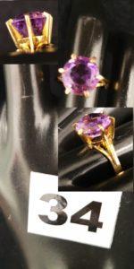 1 Bague en or réhaussée d'une améthyste ( TD 52). PB 3,9g