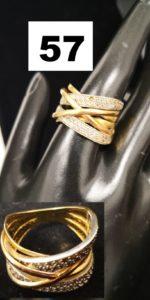 1 Bague en or jaune décoré de lignes de pierres blanches (TD 59 chaton vide) . PB 9,8g