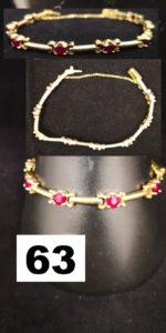 1 Bracelet en or jaune serti de 8 rubis ( L 19cm) avec chainette securité. PB 23,4g