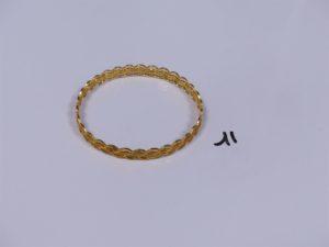 1 bracelet en or 22K rigide et ouvragé (diamètre 6,5cm). PB 16,6g