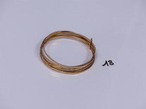 1 semainier en or tenu par une barette (diamètre 7cm). PB 29,7g