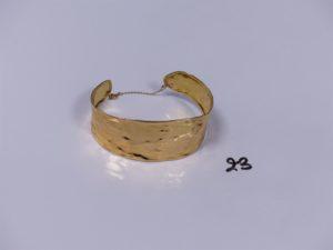 1 bracelet esclave en or avec chaînette de sécurité (diamètre 6cm). PB 11,8g