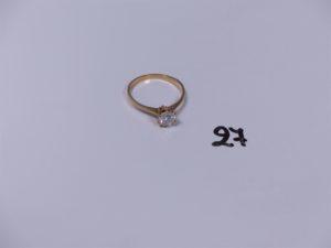 1 solitaire en or rehaussé d'un diamant central TL brillant (piqué) d'environ 1 carat (Td60). PB 2,4g