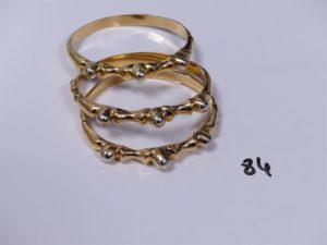 3 bracelets rigides ouvrant en or motif central bicolore (diamètre 5,5/6cm). PB 59,5g