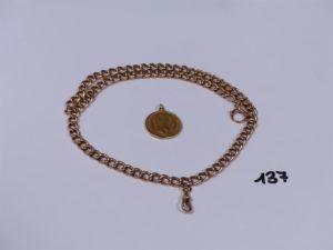 1 giletière en or et 1 breloque pièce de 20 frs NAPIII 1870 (L47cm). PB 51,2g