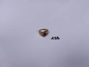 1 Bague en or ornée d'une pierre rouge et de 2 petits diamants (Td53). PB 5,1g
