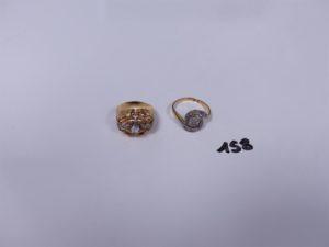 2 Bagues en or (1 ornée de petites pierres, Td49)(1 tourbillon ornée de petits diamants taille rose, Td53). PB 7g