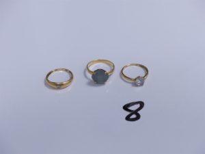 3 Bagues en or (1 ornée d'un petit diamant, Td51)(1 réhaussée d'une pierre bleue ciel, Td54)(1 réhaussée d'une pierre blanche, Td49). PB 5,7g