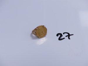 1 Bague en or serti-griffes d'une pièce de 4 Escudo 1867 (Td54). PB 7,7g