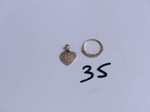 1 Alliance jarretière en or ornée d'un rang de 9 petits diamants (Td55) et 1 pendentif en or à décor d'un coeur orné de petits diamants. PB 6,9g
