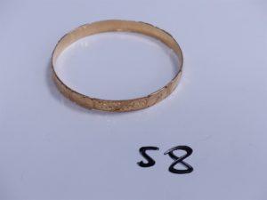 1 Bracelet en or rigide et ouvragé (Diamètre 6,5cm). PB 22,8g
