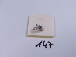 1 Bague en or réhaussée d'un diamant taille ancienne (Td51). PB 3,5g