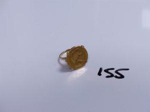 1 Bague en or serti-griffes d'une pièces de 20Frs NAP III (Td56). PB 10,7g
