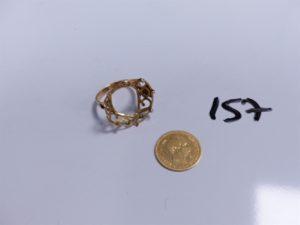 1 Bague en or serti-griffes d'une pièce de 10Frs NAP III (griffes cassées, Td56). PB 6,5g